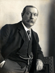 Arthur_Conany_Doyle_by_Walter_Benington,_1914